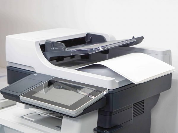 close up paper sheets on the printer in office